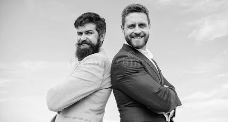 Perfect in every detail. Well groomed appearance improves business reputation entrepreneur. Business people concept. Bearded business people posing confidently royalty free stock images