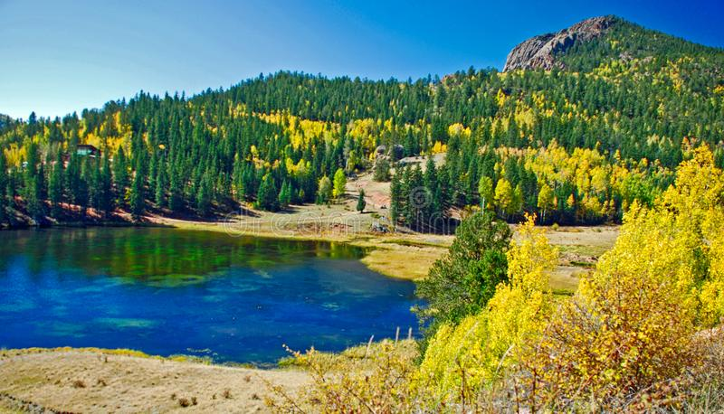 Beautiful Mountain Landscape With Lake Pines and Aspens in the Fall stock image