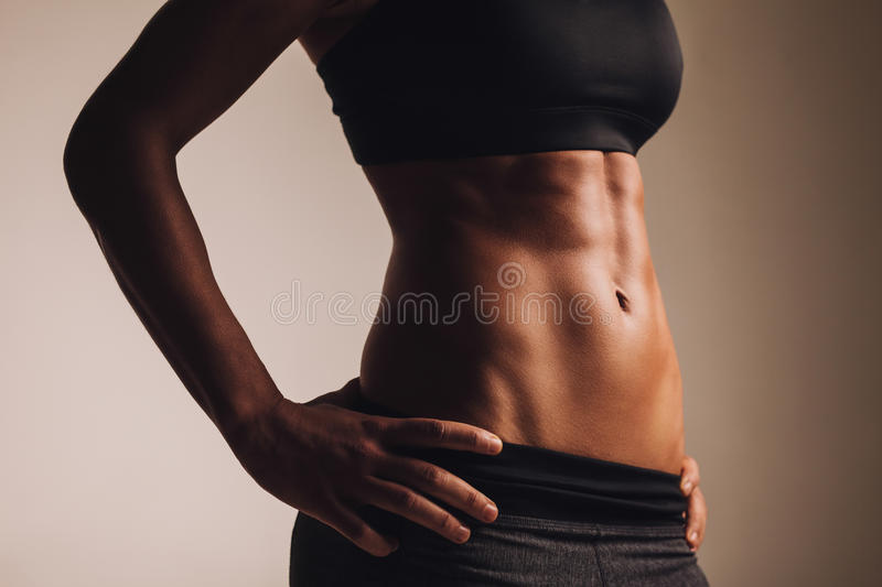 Perfect female body - abdominal muscles royalty free stock photo