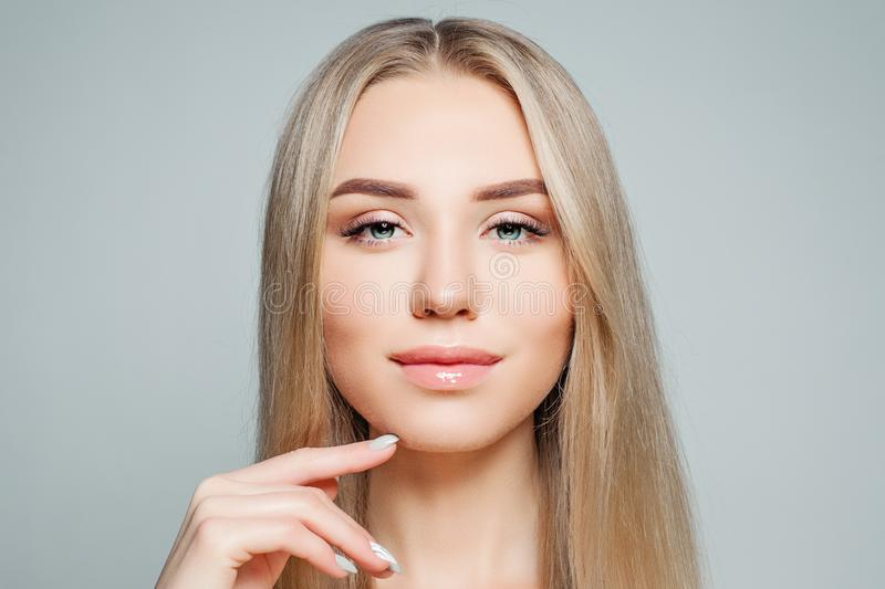 Perfect female face closeup. Blonde girl with long healthy hair and clear skin, beauty portrait royalty free stock images