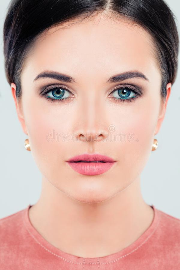Perfect female face closeup. Young woman with makeup stock image