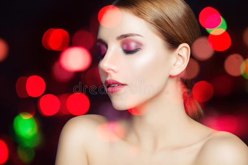 Perfect female face on sparkle bokeh background royalty free stock image