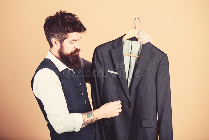 Perfect fit. Custom made to measure. Tailored suit concept. Fashion for business people. Custom made suit. Man bearded stock photo