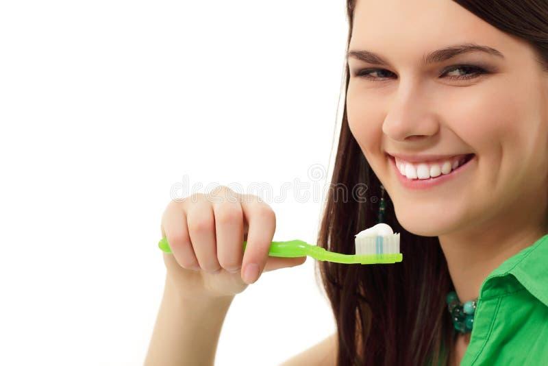 Perfect flickan för den sunda tanden för leendet den gladlynt teen arkivfoto