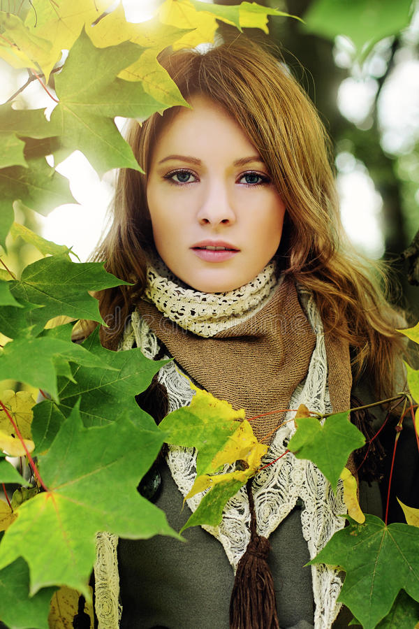 Perfect Girl wearing Lace Scarf in Autumn Park stock photography