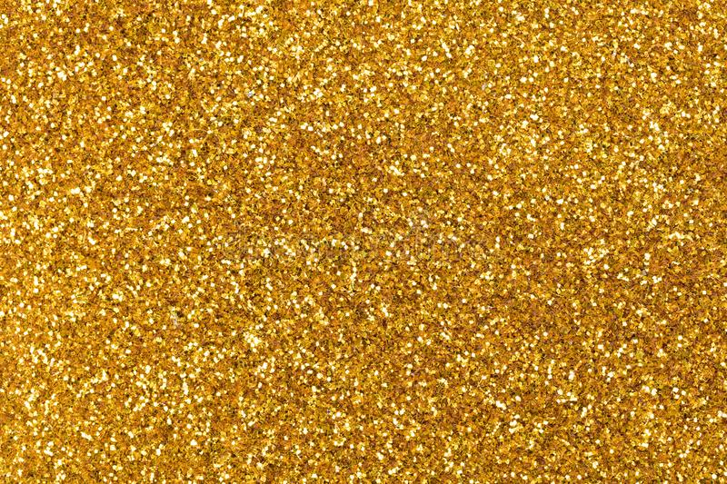 Perfect golden glitter backgroud with shiny surface as part of y royalty free stock photography