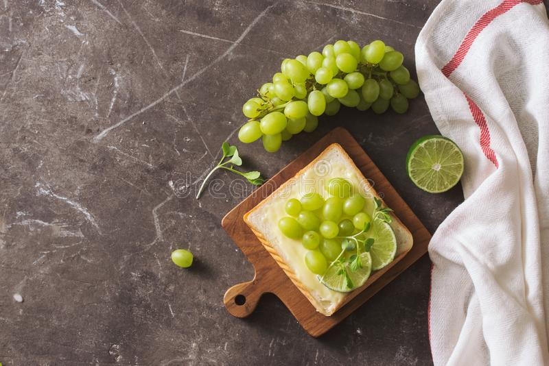 Perfect gourmet appetizer. Toast bread with green salads on top. Bread, vegetable and fruit. Diet concept royalty free stock photos