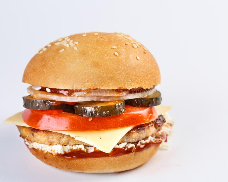 The perfect hamburger with cheese, pickles, tomato, onions and lettuce royalty free stock photography