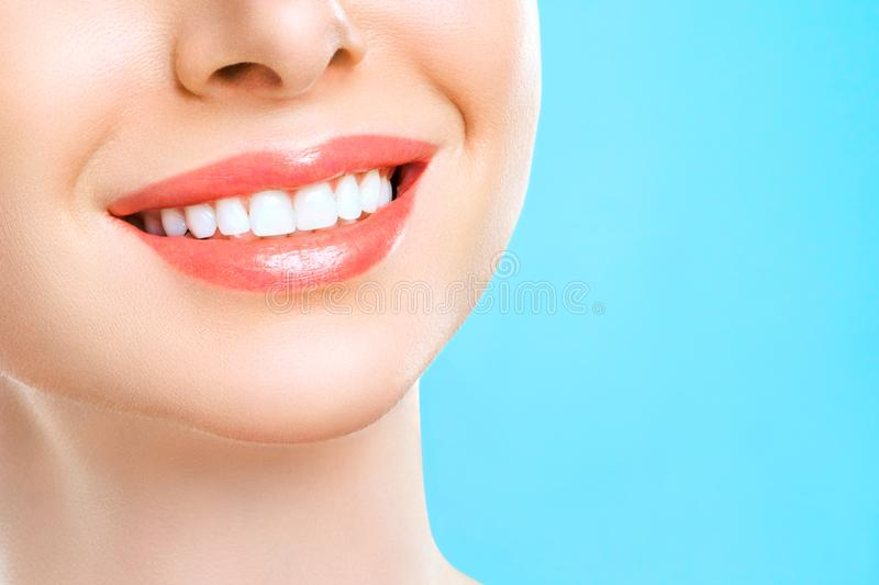Perfect healthy teeth smile of a young woman. Teeth whitening. Dental clinic patient. Stomatology concept. royalty free stock photography