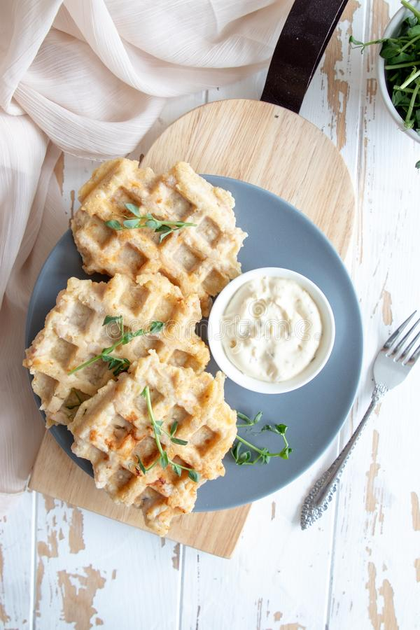 Chicken and cheese waffles with sour cream sauce royalty free stock photography