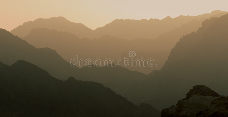 Perfect Layered Mountain. Mountains at sunset, a layered effect with darkening layers from pink to black Taken at sunset in the Sinai Desert royalty free stock photography