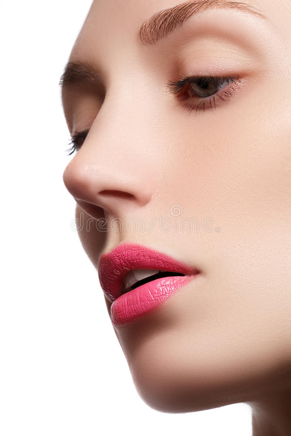 Perfect lips. Professional Make-up. Lipgloss. Closeup portrait of beautiful girl. Caucasian young woman model with bright makeup royalty free stock photos