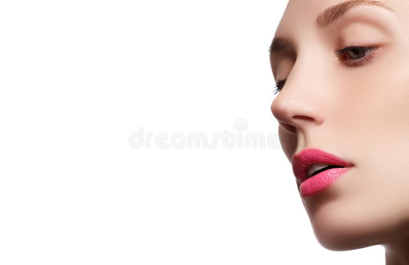 Perfect lips. Professional Make-up. Lipgloss. Closeup portrait. Of beautiful girl. Caucasian young woman model with bright makeup with perfect clean skin with stock photography