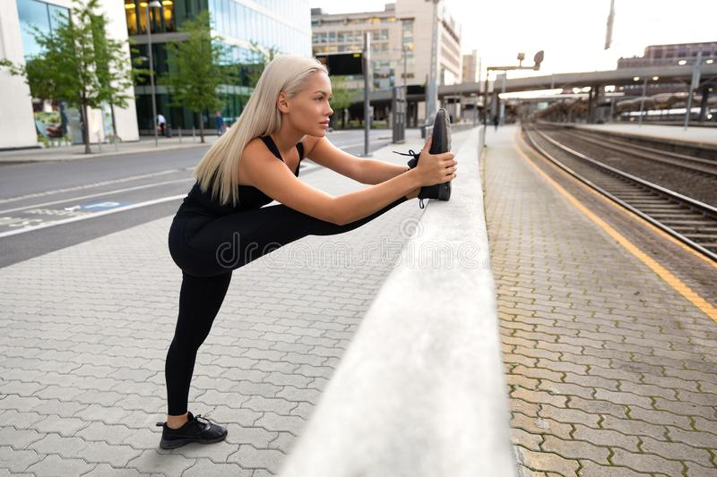 Perfect looking Urban Female Stretching Her Leg Before Exercise stock photos