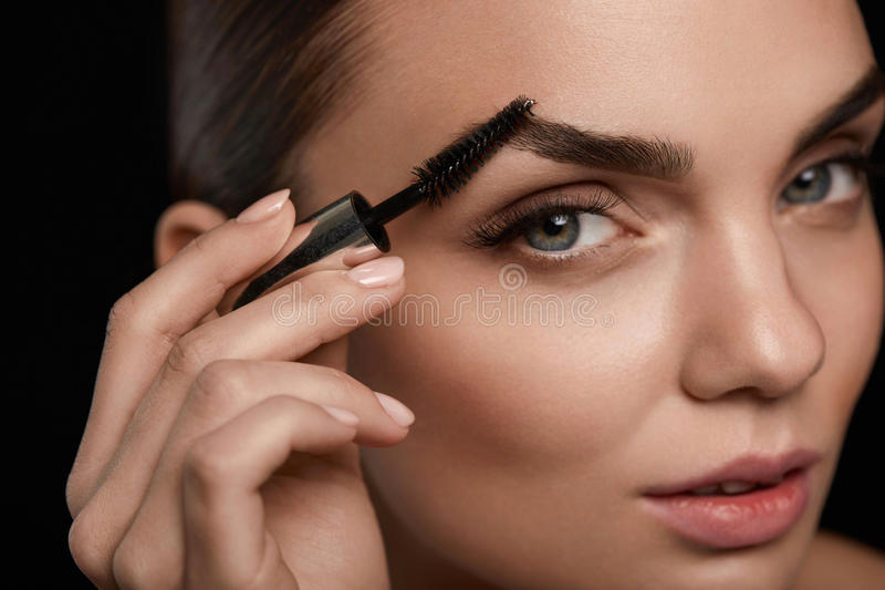 Perfect Makeup For Beautiful Woman. Brow Care For Eyebrows royalty free stock photos