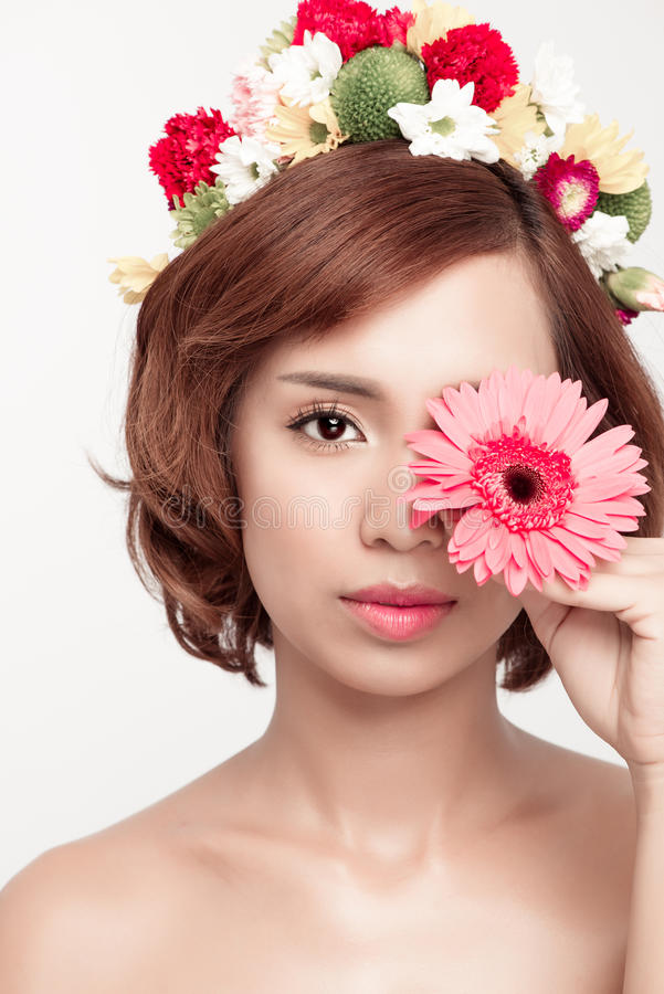 Perfect makeup. Beauty fashion. Spring woman. Beautiful asian woman with flower wreath on her head. Beauty girl with flowers hair. Style royalty free stock image