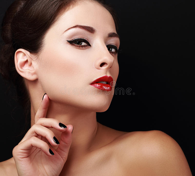 Perfect makeup woman face with red lips and black nails royalty free stock image