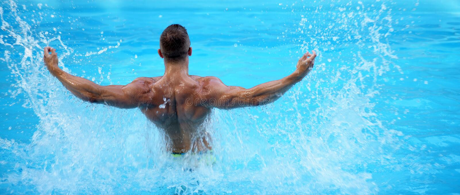 Perfect male Torso on blue water background. Maldives or Miami beach water. Handsome man having fun in summertime. Young stock photography