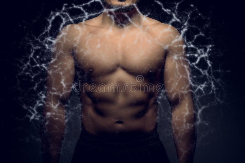 Perfect male upper body with electric energy. Concept of body transformation royalty free stock photos