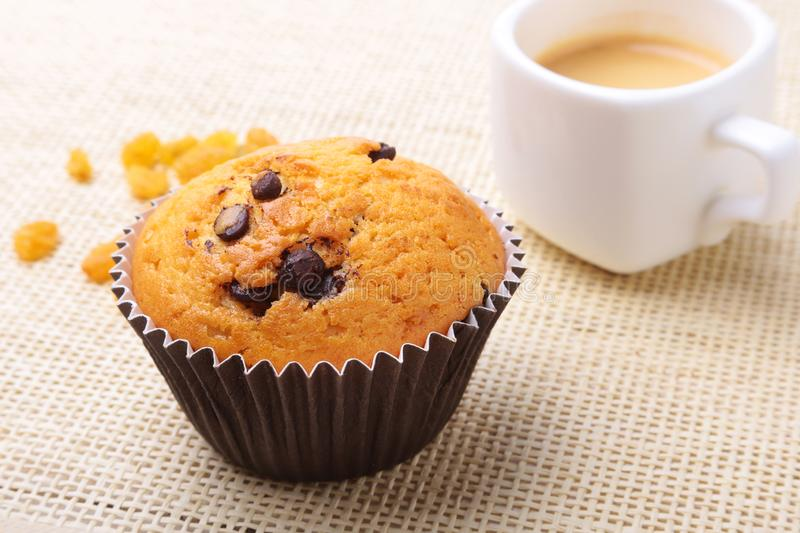 Perfect morning breakfast with Delicious homemade cupcakes with raisins, chocolate chips and espresso coffee in white stock photos