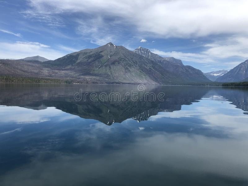 Perfect mountain reflection in the still water of Lake Macdonald in Glacier National Park royalty free stock photo