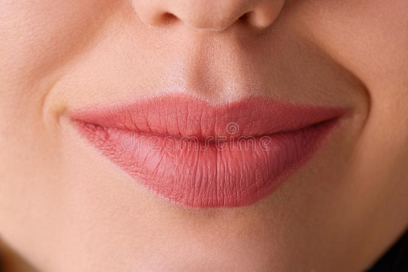 Perfect natural lip makeup. Close up macro photo with beautiful female mouth. Plump full lips. royalty free stock image