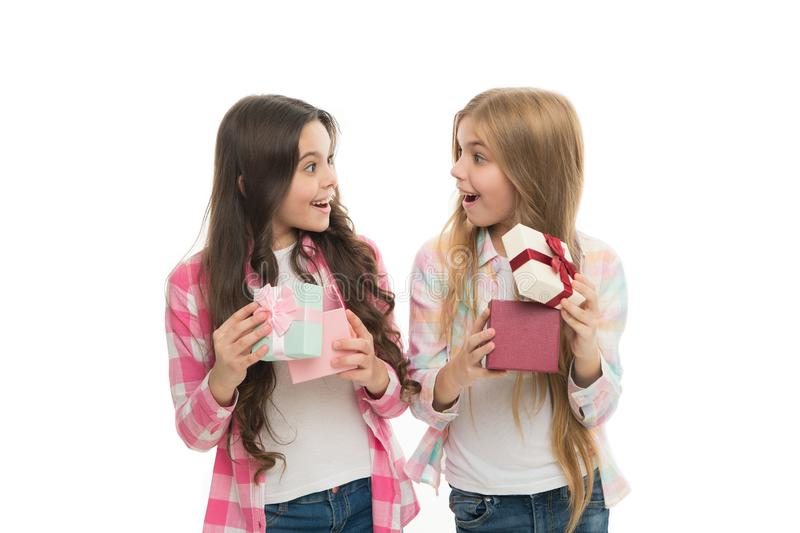 Perfect present for teen. Birthday present. Girls sisters or friends hold gift boxes. Intriguing moment. Small girls. Open holiday present. Children excited royalty free stock images