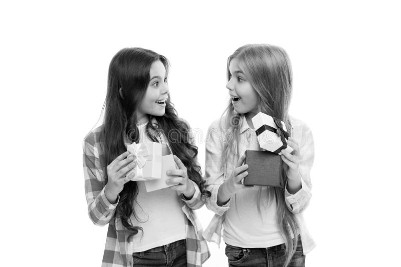 Perfect present for teen. Birthday present. Girls sisters or friends hold gift boxes. Intriguing moment. Small girls royalty free stock image