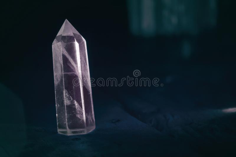 Perfect shining crystal transparent colored purple sapphire amethyst. Natural quartz in light. dark background close-up stock image