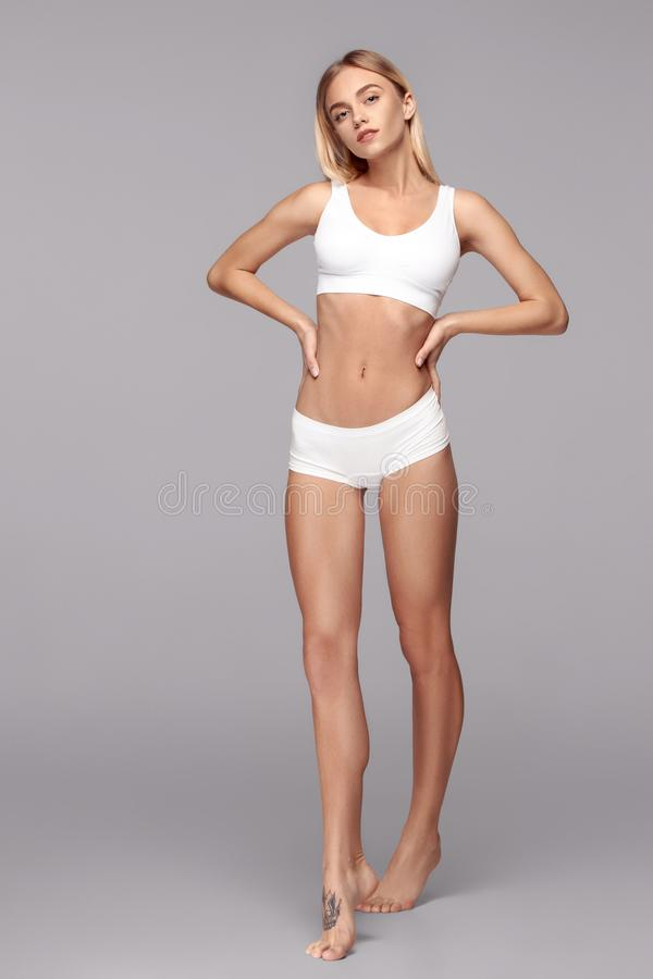 Free Perfect Slim Toned Young Body Of The Girl . Royalty Free Stock Photography - 130195787