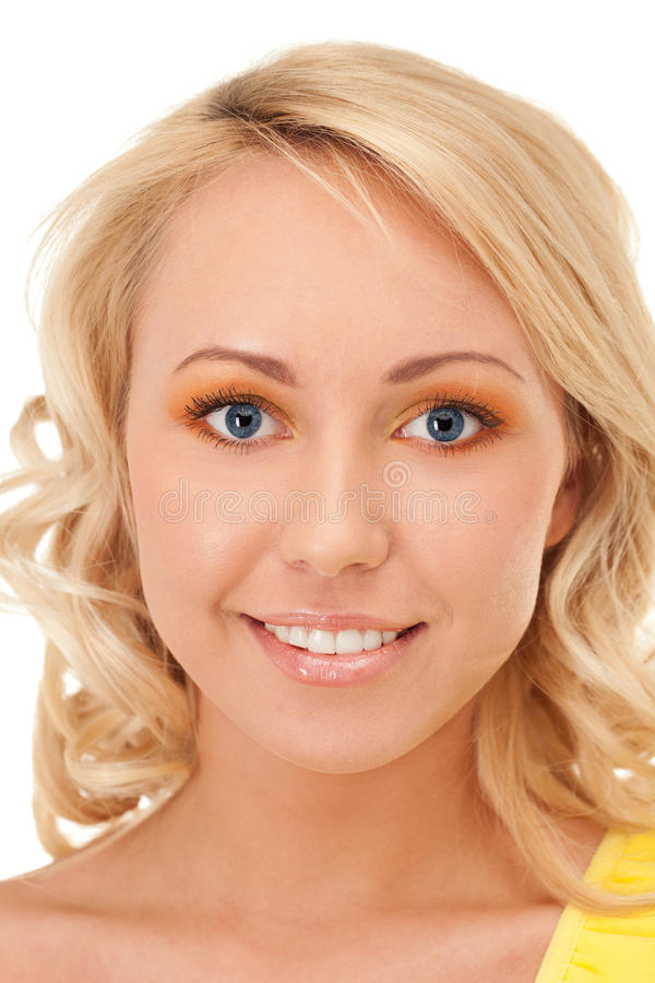 Perfect smile. Portrait of a smiling blond with blue eyes royalty free stock images