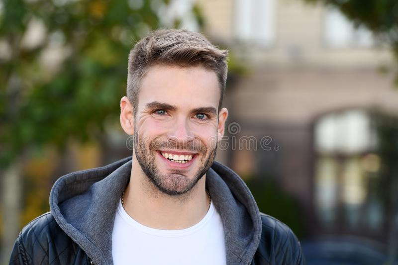 Perfect smile. Handsome guy portrait. Facial hair and skin care concept. Handsome face. Handsome man unshaven face and royalty free stock images