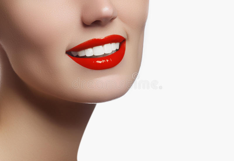 Perfect smile with white healthy teeth and red lips, dental care. Concept. Beautiful young woman`s face fragment with natural smile. Woman smile, teeth royalty free stock images