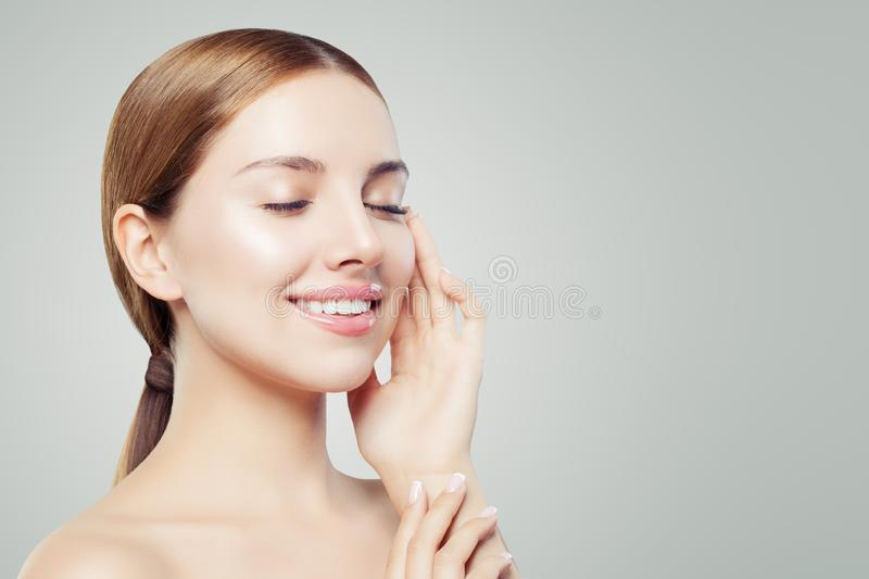 Perfect smiling girl relaxing. Beautiful woman with healthy skin, eyes closed. Skincare and cosmetology concept.  stock images