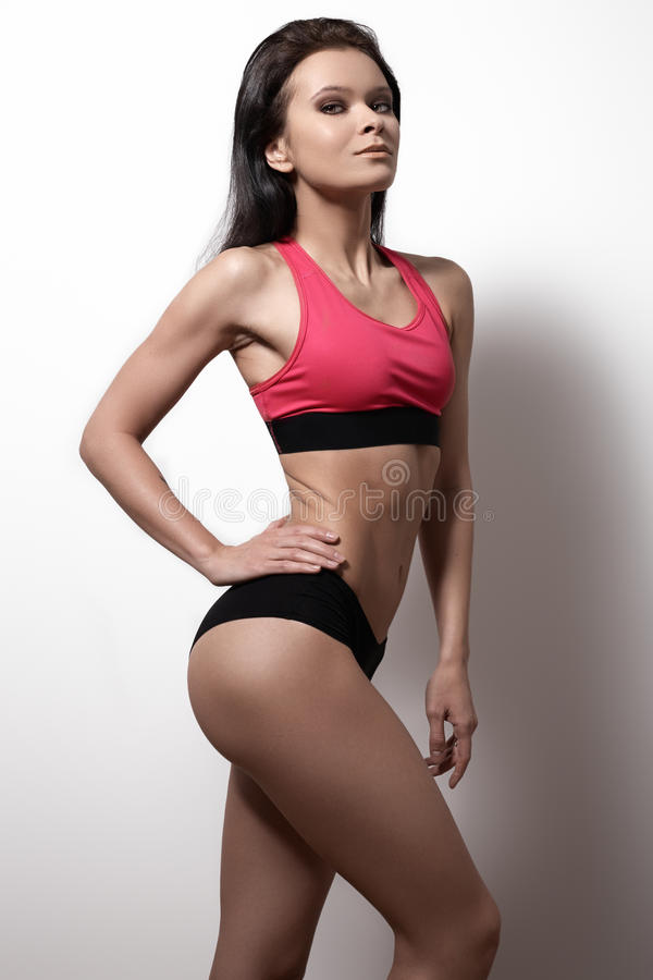 Perfect sports female model. Healthy lifestyle, diet and fitness. Beautiful slim female body. Voluptuous woman's shape with clean healthy skin, flat stomach royalty free stock photos