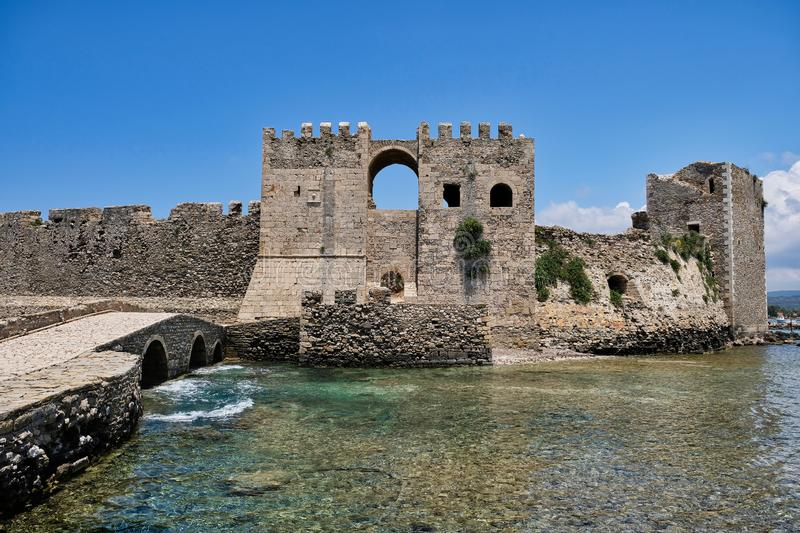 Methoni Castle, Western Peloponnese, Greece. A perfect summer day in Methoni, Western Peloponnese, Greece. Medieval Methoni Castle fortifications, and clear blue stock photo