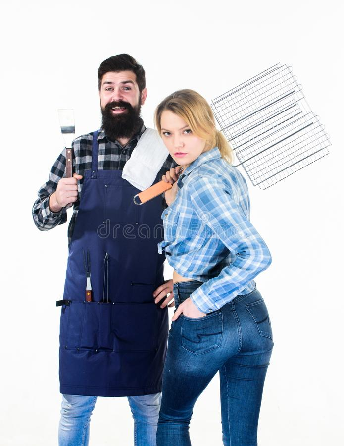Perfect summer lunch. Tools for roasting meat. Man bearded hipster and girl. Preparation and culinary. Family weekend royalty free stock photo