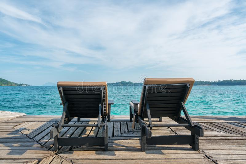 Perfect summer tropical paradise beach with lounge chairs at resort in Phuket, Thailand. Vacation summer holidays and travel royalty free stock image
