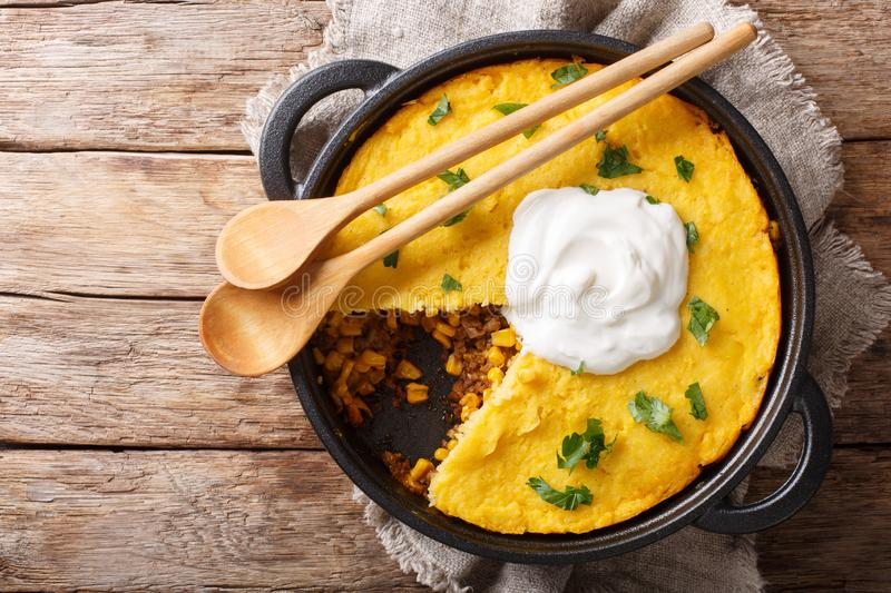 Perfect Tamale Pie Recipe - Rich zesty beef filling topped with fluffy corn bread closeup. horizontal top view stock photos