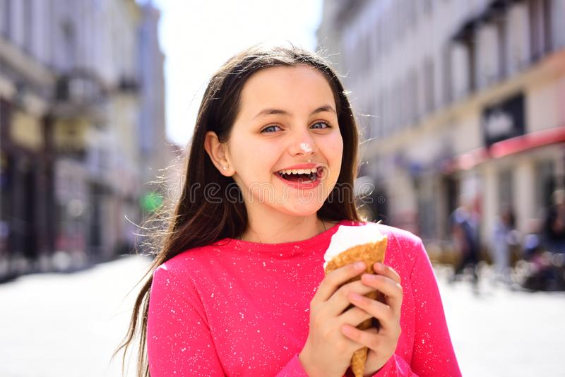 Perfect taste and sweetness. Cute girl smiling with ice cream. Enjoying frozen food snack or dessert. Pretty girl hold. Ice cream cone on summer day. Happy girl stock images