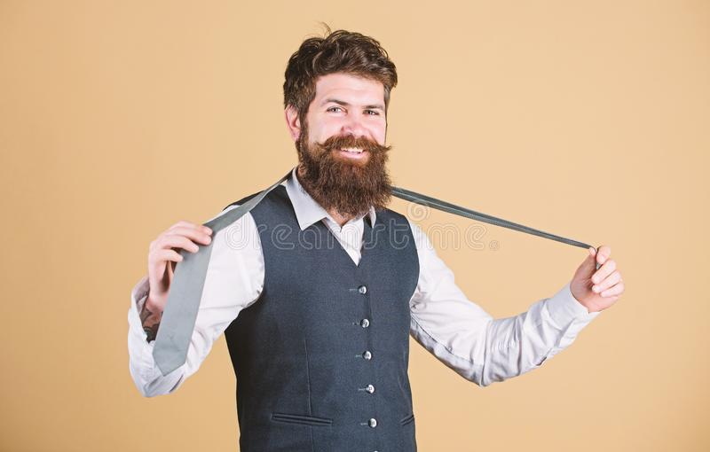 Perfect tie. Fashionable man. Bearded man holding necktie. Brutal guy wearing fashionable classy clothes and accessory. Businessman in fashionable hipster stock photos