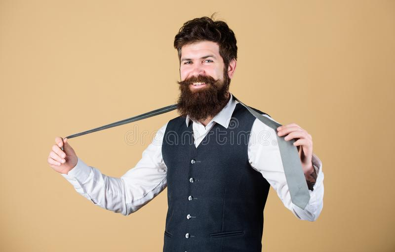 Perfect tie. Fashionable man. Bearded man holding necktie. Brutal guy wearing fashionable classy clothes and accessory. Businessman in fashionable hipster royalty free stock photography