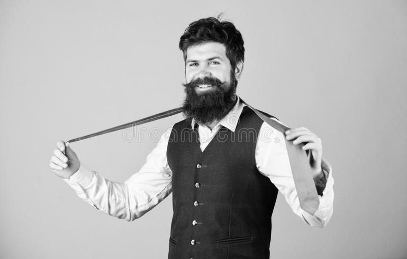 Perfect tie. Fashionable man. Bearded man holding necktie. Brutal guy wearing fashionable classy clothes and accessory. Businessman in fashionable hipster stock image