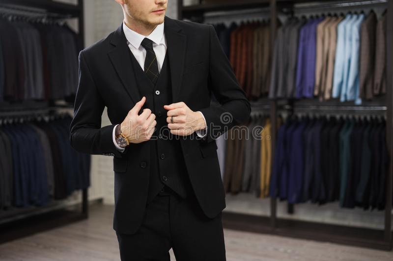 Perfect to the last detail. Modern businessman. Fashion shot of a handsome young man in elegant classic suit. Men`s royalty free stock image
