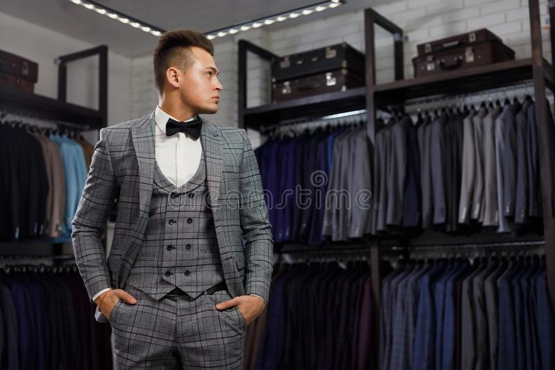Perfect to the last detail. Modern businessman. Fashion shot of a handsome young man in elegant classic suit. Men`s stock image