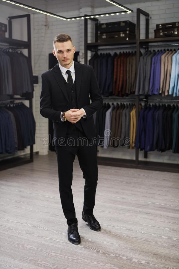 Perfect to the last detail. Modern businessman. Fashion shot of a handsome young man in elegant classic suit. Men`s stock photo