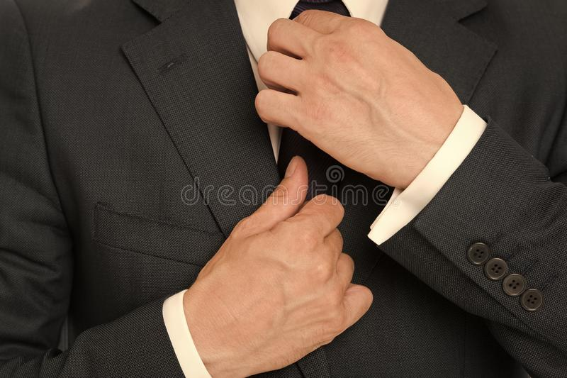 Perfect to the last detail. Stylish details business appearance. Business style dress code. Male hands fixing tie. Business style outfit. Confident in his style royalty free stock photos