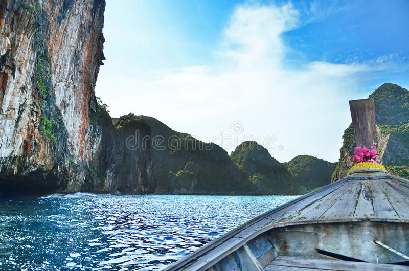 Perfect tropical bay on Koh Phi Phi Island, Thailand, Asia. Traditional wooden boat in a picture perfect tropical bay on Koh Phi Phi Island, Thailand, Asia stock images