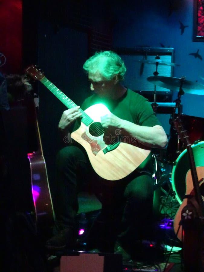 Perfect Wave guitarist, Michael Tanenbaum, plays guitar left han. HONOLULU - FEBRUARY 7, 2017: Perfect Wave guitarist, Michael Tanenbaum, plays guitar left stock photos