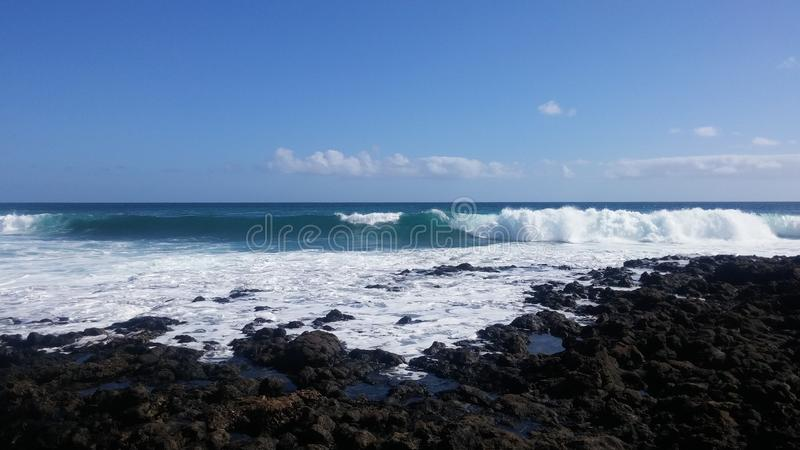 The perfect wave. In the ocean that bathes Lanzarote Spain stock image